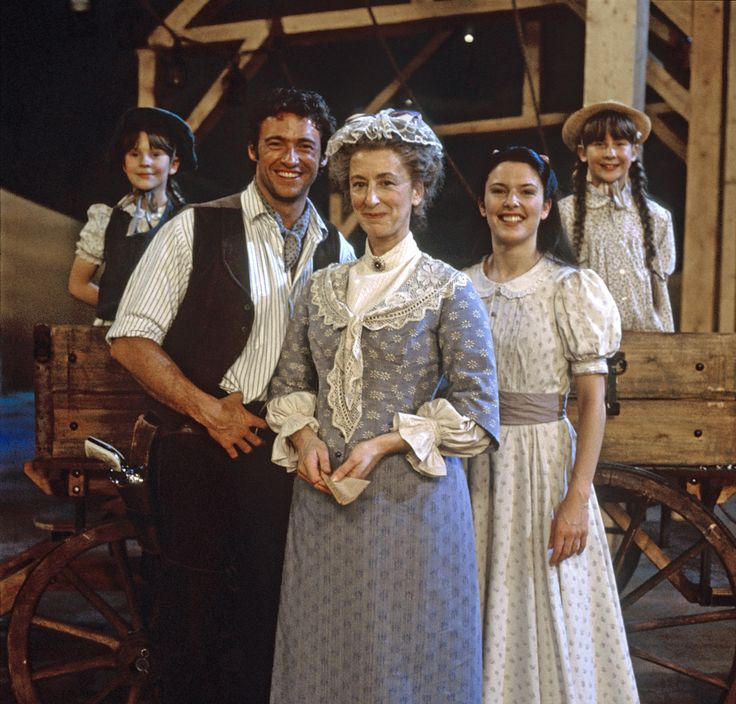 Hugh Jackman heads the mostly British cast as Curly, the role that propelled him to international stardom after Nunn's production opened at London's Royal National Theatre in 1998. Description from channelserf.com. I searched for this on bing.com/images