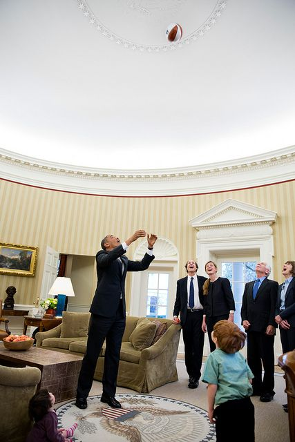 President Barack Obama throws a basketball in the air during departure photos with Samantha Power, Senior Director for Multilateral Affairs and Human Rights, and her family in the Oval Office, Feb. 22, 2013. Watching the President, from left, are: Rian Power-Sunstein, Cass Sunstein, Samatha Power, Declan Sunstein, James Bourke, and Veronica Delany. (Official White House Photo by Pete Souza)