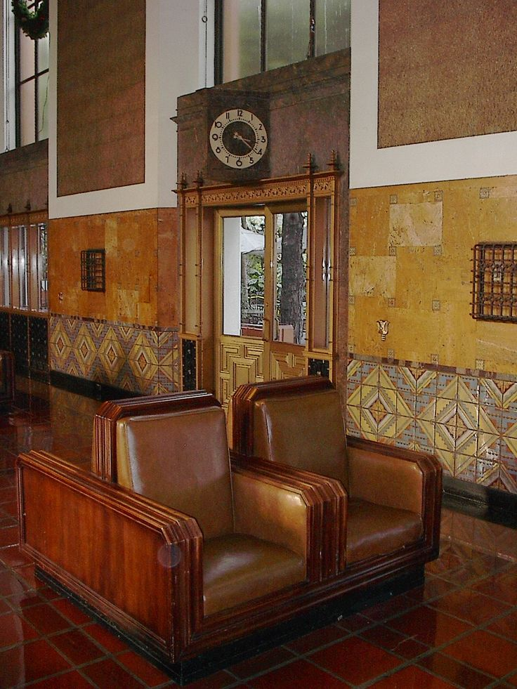 Union Station, Los Angeles. Popular in America post world war 1 and pre world war 2. Sweeping curves used in furniture design, and the walls feature pattern and symmetry, creating balance.