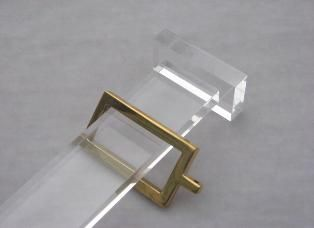 The Modern Sophisticate: Objet D'art: Lucite Curtain Rod with Gold Square Rings