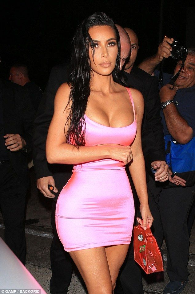 646a6f67 Pretty in pink: Kim Kardashian stunned in a plunging, pink cutout dress as  she arrived in West Hollywood for sister Kylie Jenner's 21st birthday dinner