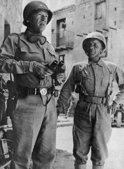 """Patton & Teddy Roosevelt Jr (1943) This past week I spoke with a D Day veteran who told us he was on the same vessel going into Normandy as Teddy Roosevelt (the younger). He was helped over the side by a man who said """"Good luck son."""" Not having a clue who that man was he got into the LST. Another fellow said. """"Do you know who that was! That was Gen. Roosevelt!."""