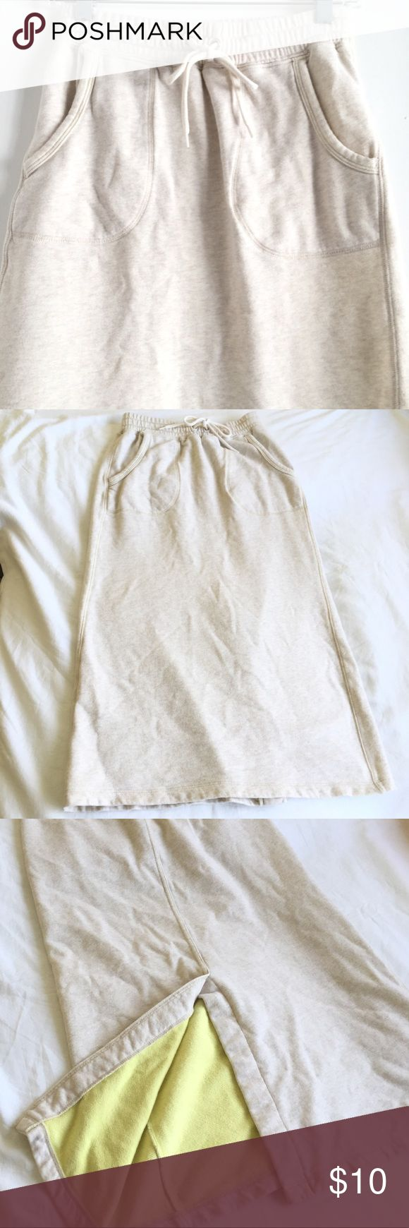 """Uniqlo Cotton Drawstring Maxi Skirt Xs Gently used Uniqlo maxi skirt. Perfect loungewear. Color is light oatmeal brown outside with soft yellow inside. Very cute skirt for everyday use.  Approximate measurements: Waste 13"""" Length 31""""  100% cotton.  From pet and smoke free home Uniqlo Dresses Maxi"""