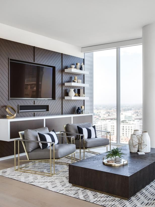 Contemporary Neutral Living Room With Column The Condo Uses The Urban Setting Of Downtown La To Inspir Condo Living Room Small Condo Living Neutral Living Room