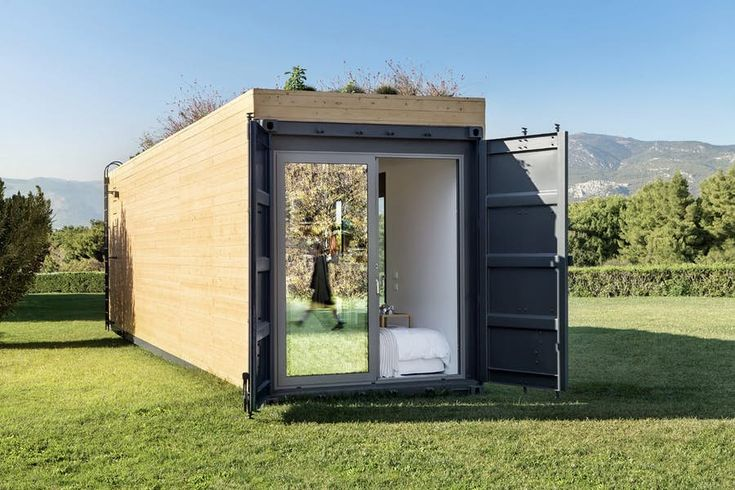 Cocoon Modules' shipping container house has a bedroom that opens to the outside