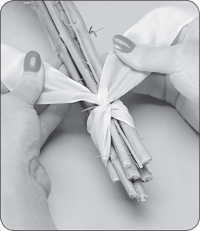 How to Wrap Bouquet Stems | Continue to wrap underneath 'the stems, bringing the ribbon forward ...