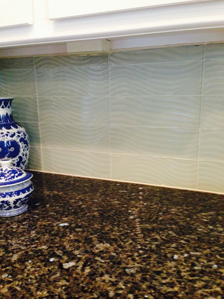 Granite Countertop With Wave Textured Glass Tile Kitchen