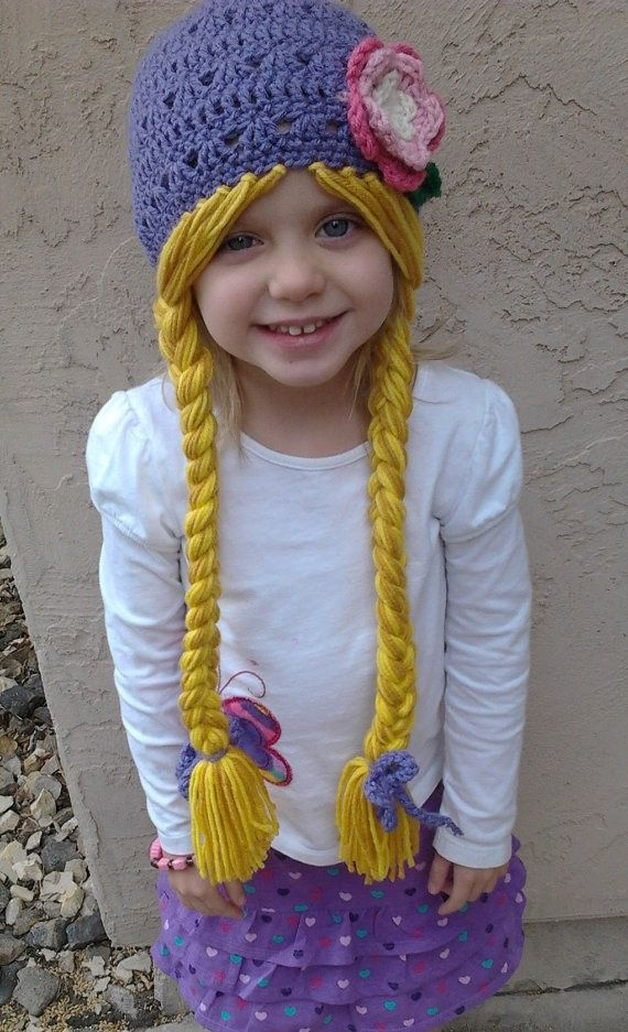 Such a cute idea. Purple Rapunzel Character Hat with Long Braids by Evermicha, $25.00... Gonna have to figure out a knitted Pattern to do this with!: