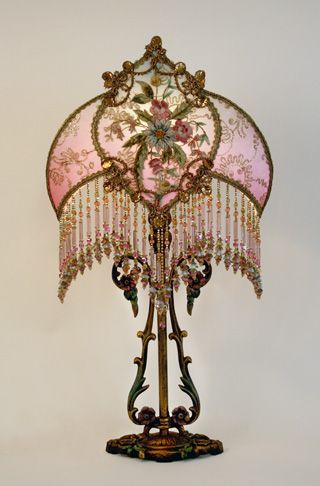 171 best lamps images on pinterest night lamps art deco lamps and ornate milcast antique table lamp with art nouveau styling holds a custom talisman shade dyed pale blue to pink and covered in antique gold metallic lace aloadofball Choice Image