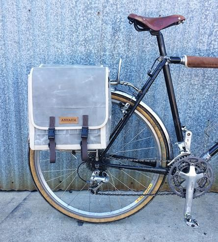 Made for bike riding, this waxed canvas pannier bag features straps and pockets to hold all your travel ins and odds.