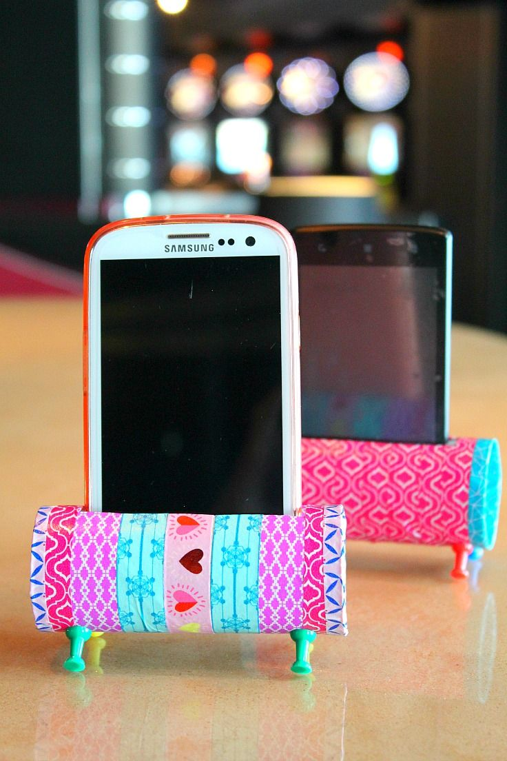 Easy DIY Phone Holder using decorative tape, toilet paper rolls and push pins!