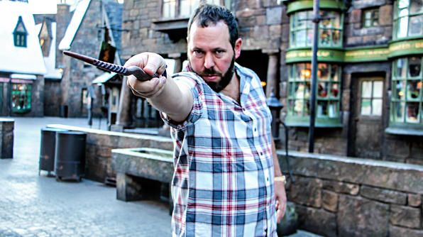 Florida- Bert casts a spell towards the camera while standing in the streets of Hogsmeade Village: Photo