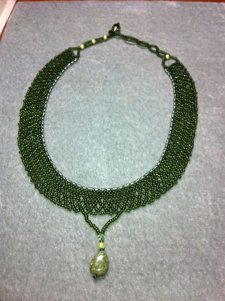 Green seed bead netted necklace with kiwi jasper drop