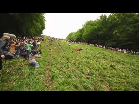 The Gloucester Cheese Roll on Coopers Hill . this film of the 2012 event is great!     The official web site. http://www.cheese-rolling.co.uk/index1.htm  >> The Gloucester Cheese Roll, where locals try and catch cheese rolling down Cooper's Hill. a 200 year long tradition. Gloucester, #England