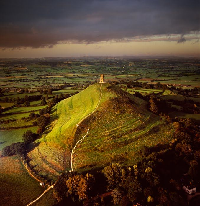 The landscape of our 'Land of the summer folk' route is dominated by Glastonbury Tor, which can be seen in three counties. www.bradtguides.com