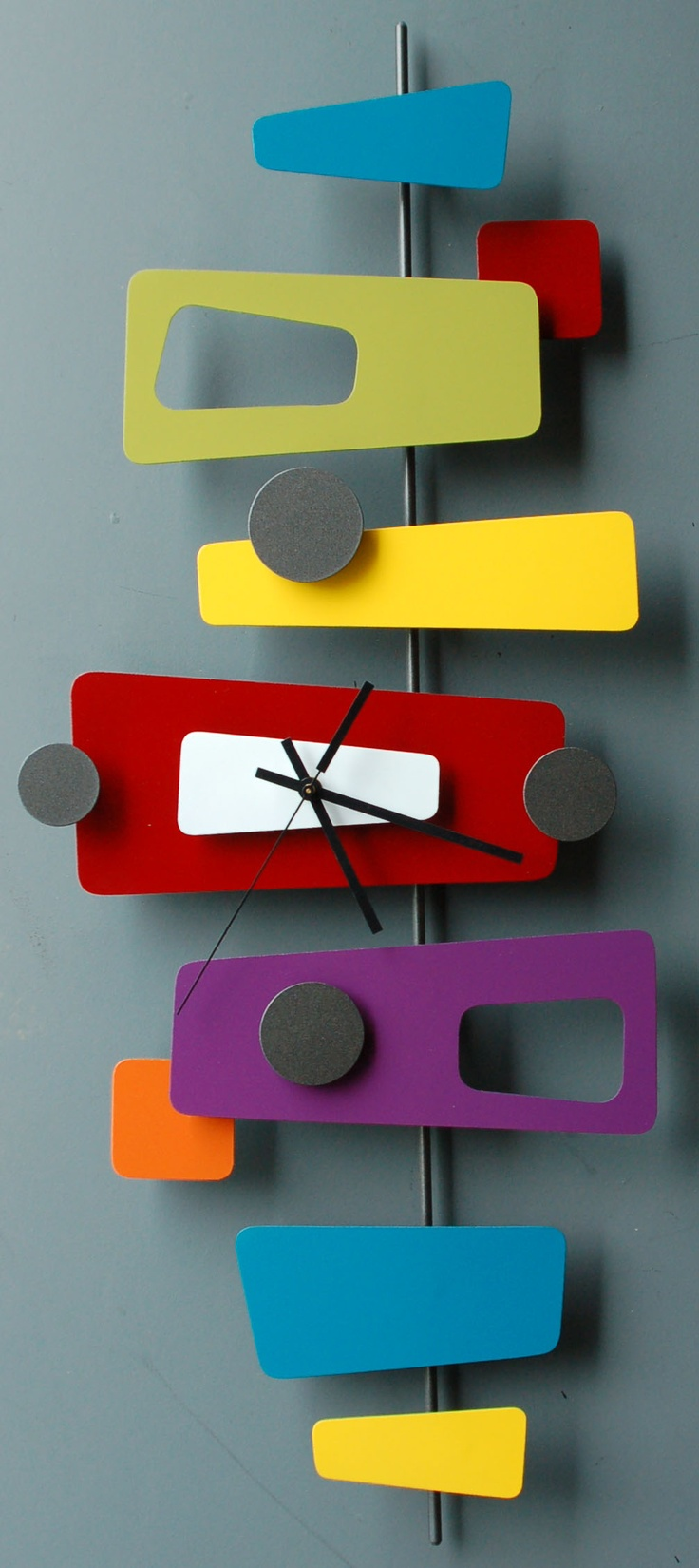 Googie-inspired modern retro metal art sculpture clocks by Steve Cambronne