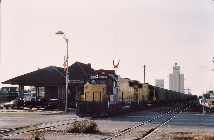 https://flic.kr/p/doYTW9 | CNW at Spencer Iowa 1982 , | We go back 30 years ago with C NW GP38's with EB a grain train going past the Milwaukee Rd train station at Spencer Iowa