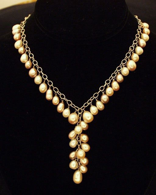 "Natural cultured freshwater pearl and solid sterling silver necklace. Approximately 15""/38cm 17.5""/44cm long. Cultured freshwater pearls are symbolic of prosperity and beauty and are thought to enhanc"