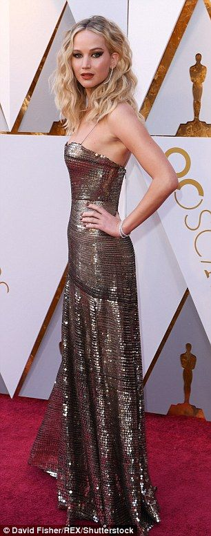 Vision in gold: Lawrence showed off her slender figure in an embellished gown with spaghetti straps