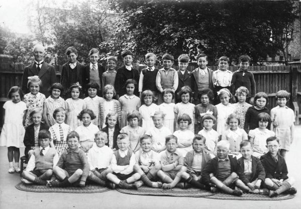 Schoolmaster with 45 children at St Georges School Brentford. My Grandad is in the front row, 3rd along! (1934..?)
