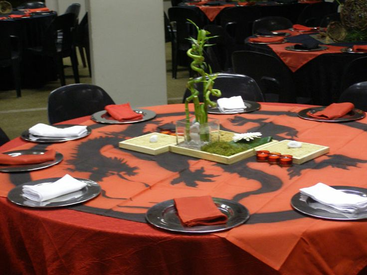 Chinese themed table with a dragon print overlay in red and black www.iceevents.co.za