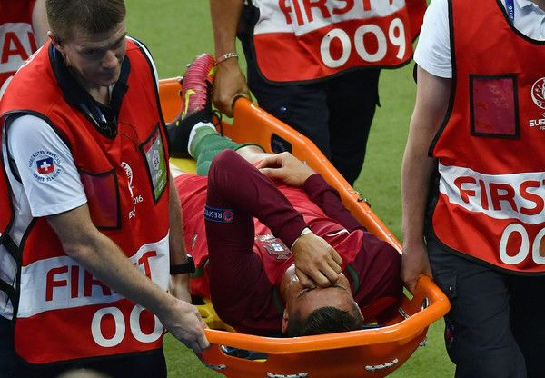 Cristiano Ronaldo of Portugal shows his emotion while being taken off by a stretcher during the UEFA EURO 2016 Final match between Portugal and France at Stade de France on July 10, 2016 in Paris, France.