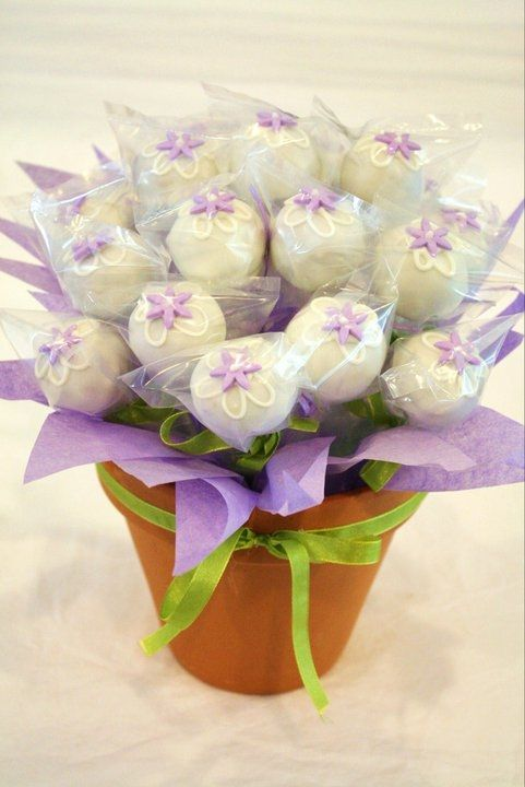 cake pop bouquet...  I like the idea of adding the tissue paper in the flower pot