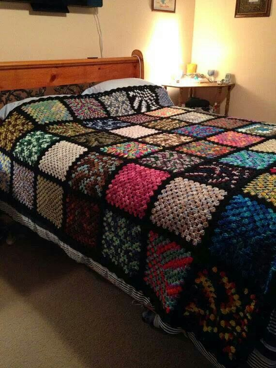 56 different varigated granny squares made into a king size blanket. Created by Barbara McManaman