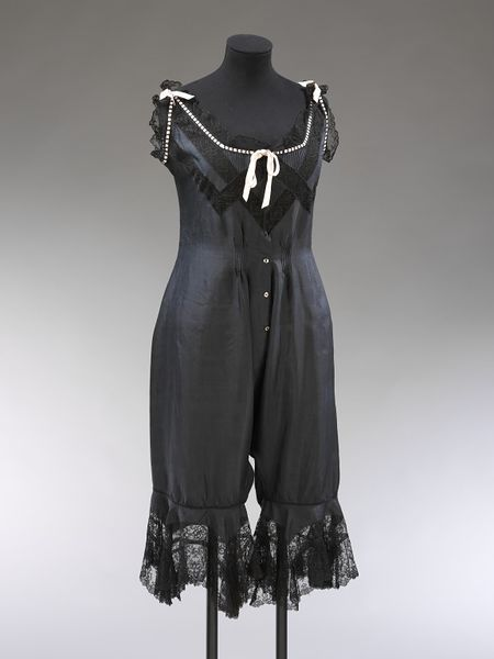 Black silk combination undergarment with black lace and pink ribbon trim, English, ca. 1905.