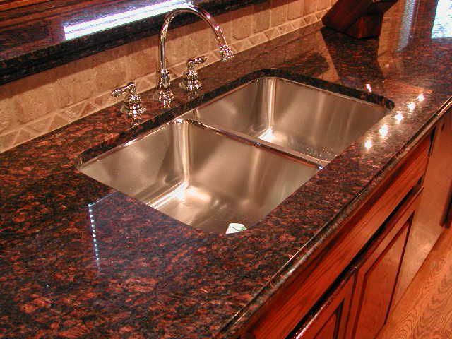 Tan brown granite with cherry cabinets