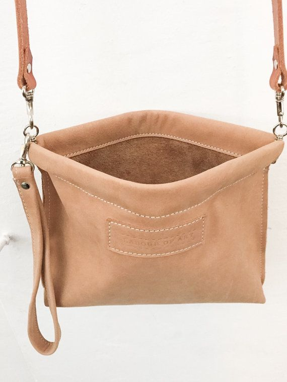 This Soft Leather Clip Frame Bag could be your cute companion. It is a stylish powder colored charm bag and easy to carry and store all your small