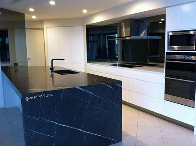 Lovely black stone bench top in this kitchen, designed by one of our own! #kitchensbyverto #vertokitchens