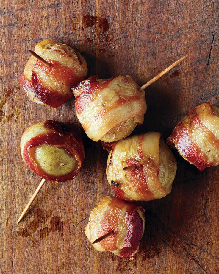 Bacon-Wrapped Potatoes | Martha Stewart Living - To concoct this ultra-simple irresistible appetizer, wrap tiny new potatoes in strips of bacon and let the oven do the rest. Add a side of Lemon Aioli for dipping if you like.