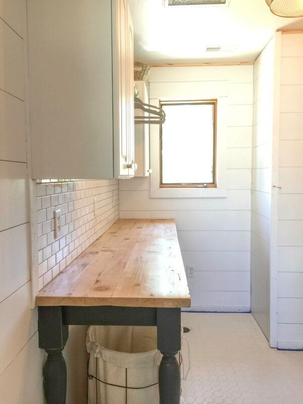 This DIY laundry folding table is such a beautiful addition to my laundry room!