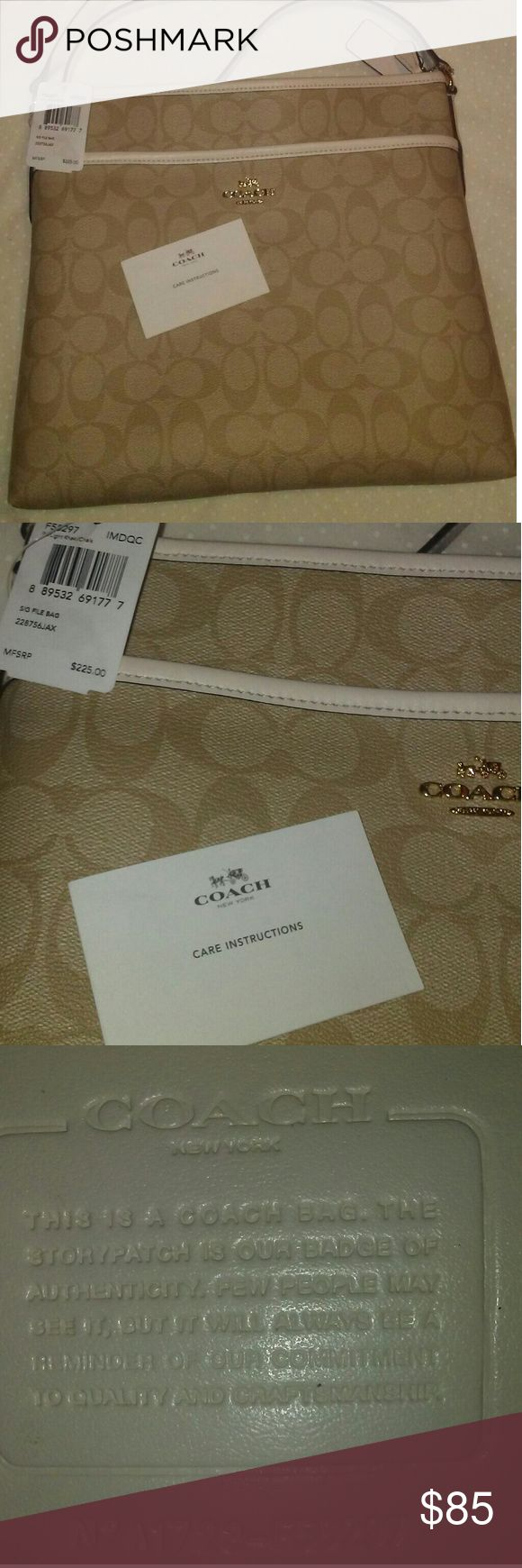"""Coach File Crossbody bag NWT file crossbody Beige/white Authentic....has a couple blue smudges on the shoulder strap from my little girl-she decided to use it to,play dress up--but other than that there are no marks, they aw barely noticeable (see pic) Has a large pocket on the front, the inside has a large zipper picket on one side ad 2 smaller pockets on the other side Adjustable shoulder s rap Roomy but not too big Still has price tag and """"care instructions"""" & freshness packet or still…"""