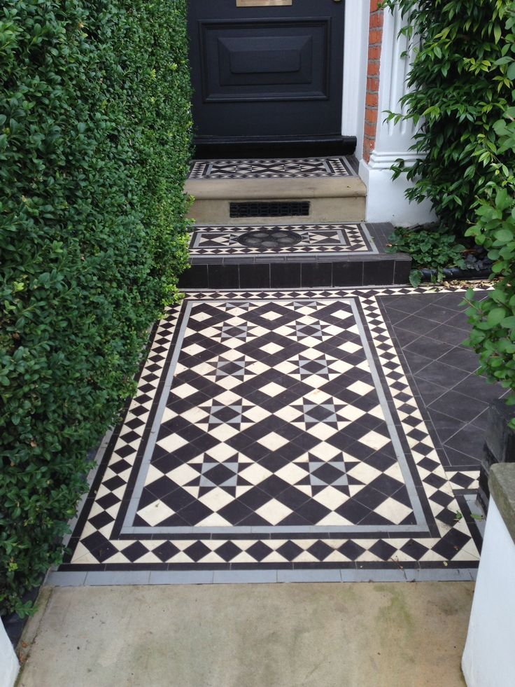 Victorian Tiled Path grey & black would look goof against the woodwork