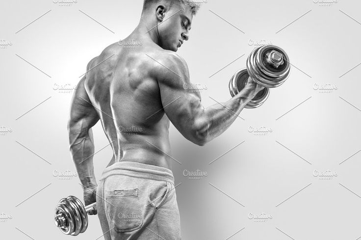 Male bodybuilder with dumbbell by Usmanov Stock Photography on @creativemarket