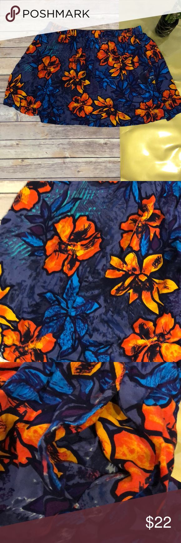 Floral French Connection Skirt XL Super fun Floral multi color skirt with elastic waist and hidden pockets. Blue, Purple, Orange, Aqua Blue etc.  16.5 waist length  17 length Excellent condition French Connection Skirts Mini