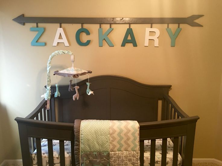 DIY Arrow name nursery sign in gray and teal baby boy nursery with Uptown Giraffe crib set.