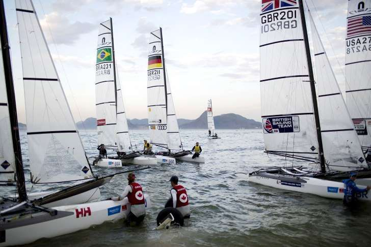 Athletes from the Nacra 17 Mixed Multihull class return to Flamengo beach after…