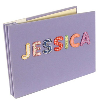 Personalised Baby Photo Album.    A lovely Gift for Baby Personalised baby photo album gift in Lilac. This  luxury baby photograph album is covered in soft touch velvety fabric. They have easy to use slip in sleeves for your photos, and hold up to 40 6 x 4 pictures. Each personalised baby photograph album can have up to 8 letters for the name of your choice.