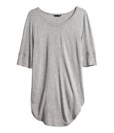 Short-sleeved jersey top with rounded hem and ribbed cuffs 100% rayon. Machine wash cold