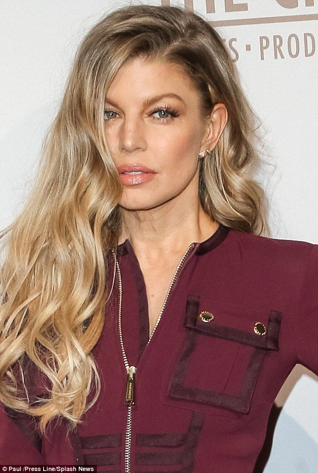 Fergie covers up her Humps in trendy burgundy dress at Spotify Creators party... but can't resist flashing her long legs | Daily Mail Online