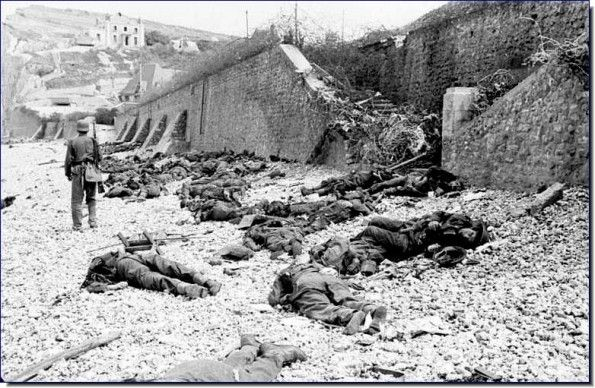 After the Allied raid on Dieppe, 19th August 1942. Allied dead lie on the beach.