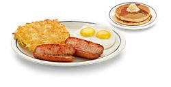 Two smoked sausage links served with two eggs, hash browns and two buttermilk pancakes on the Breakfast Combo menu at IHOP.