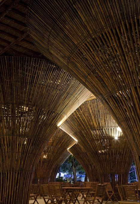 Kontum Indochine Cafe with conical bamboo columns by Vo Trong Nghia