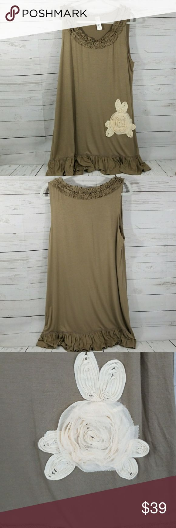 """Lilypad tunic tank Ruffles are on trend and this Lilypad long tunic tank does them in the cutest way. Neutral taupe with a cream color flower. This top is crying out for leggings and cute sandals. NWOT. (Bust is 21"""" laid flat. Size tag is 3 XL, but listing at 16 based on bust size.) Lilypad Tops Tunics"""