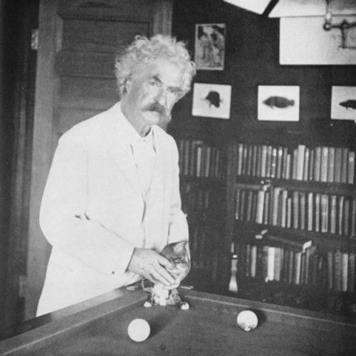 """""""If man could be crossed with the cat, it would improve man but deteriorate the cat."""" Mark Twain, seen here with his kitten on the billiard table.)"""