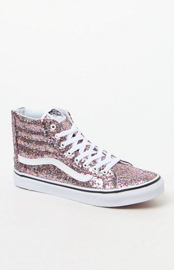 PLEASE NOTE: This shoe is offered in Men's sizes; please consult the Size Chart above - the conversion is a size and a half smaller for women. For example, a woman who is a size 7.5 should order a size 6 in Men's.  Vans supplies a sparkly, slimmer version of their classic lace-up high-top. The Chunky Glitter Sk8-Hi Slim Zip Sneakers have textile uppers with chunky glitter throughout, comfy, supportive padded collars, and a zipper entry at the heel.   	High-top sneaker 	Lace-up closure…
