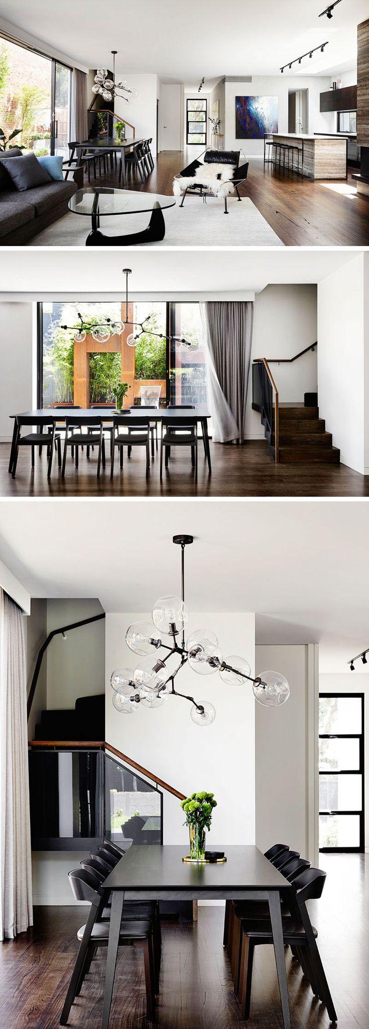Этот современный интерьер открытой планировки закрепляет обеденный стол в пространстве, используя люстру.